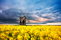 Chesterton Windmill at sunset in a spring storm