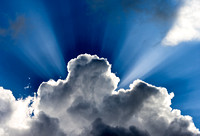 God rays behind clouds